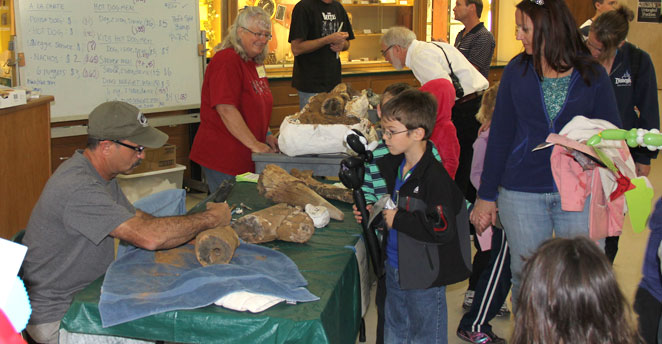 Slide: See experts prepare fossils!