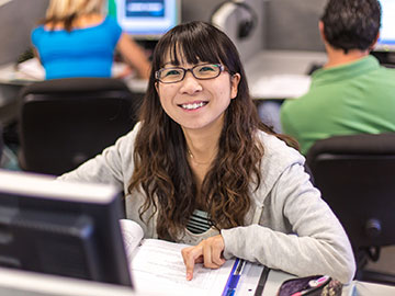 A girl smiling at the ESL class